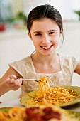 Girl eating spaghetti