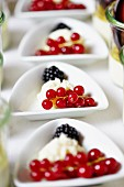 Mascarpone cream with fresh berries on a buffet