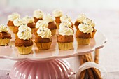 Gingerbread and pumpkin cupcakes decorated with silver pearls for Christmas