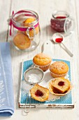 Muffins with cherry jam and icing sugar