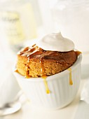 Souffle with caramel sauce and cream