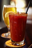 A Bloody Mary and a glass of beer