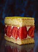 A strawberry slice with pistachios nuts