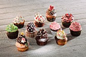Colouful cupcakes decorated with various different creams