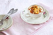 Porridge with banana and caramel sauce in a floral coffee cup