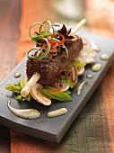 Marinated beef fillet on a lemongrass skewer with a leek and mushroom salad (Asia)
