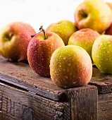 Freshly washed apples on a wooden crate