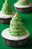 A cupcake decorated to look like a Christmas tree