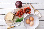 Cherry tomatoes, eggs, Parmesan, basil, onion, garlic and flour