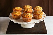 Cranberry and orange muffins on a cake stand