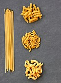 Various types of pasta on a slate sheet