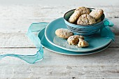 Biscuits in a turquoise bowl with a ribbon