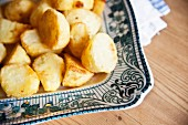 Roast potatoes on a square serving platter