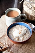 Porridge with yogurt and cinnamon served with a mug of tea