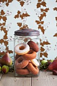 A jar of sugared and iced doughnuts