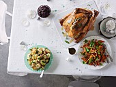 Dry-brined turkey with cranberry relish and verjuice pan juices, Roast potato salad with mustard salad cream and Carrot salad with coriander, parsley, almonds and sherry vinaigrette