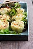 Mini potato gratin on a bed of lettuce leaves