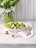 Easter salad with cucumbers, radishes and egg