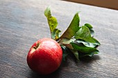 A red organic apple with leaves