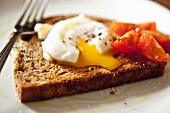 Poached egg on wholemeal toast with cherry tomatoes