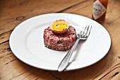 Steak tartare with egg and Tabasco sauce