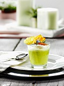A glass of green asparagus soup