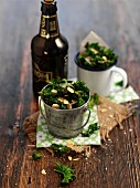 Green kale with slivered almonds and a bottle of beer