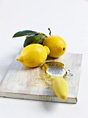Lemons and a grater with lemon zest