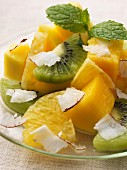 Exotic fruit salad with pineapple, kiwi, mango and coconut