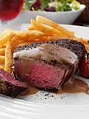 Beef steak with chips, tomatoes and gravy