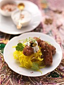 Lamb kebab with coriander raita on a turmeric and herb salad (India)