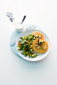 Potato cakes with ham, rocket and sweetcorn