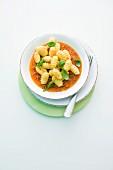 Gnocchi with tuna sauce and basil
