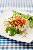 Prawns on a bed of rice with mange tout