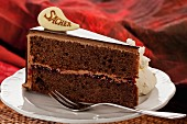 A slice of Sachertorte (rich Austrian chocolate cake)with cream