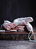 Salami, sliced, on a chopping board