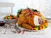 Roast turkey with bacon and oranges (carved) for Christmas
