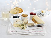 A cheese platter with crackers and various jams for Christmas