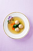 Clear broth with carrots and matze dumplings