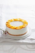 Citrus fruit and coconut pana cotta with orange slices