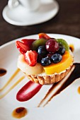 A fruit tartlet with fruit sauces