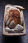 Country bread in a rustic wooden dish