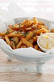 Chips with salt, rosemary and mayonnaise