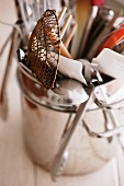 Various kitchen utensils in a metal pot