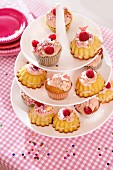 Raspberry cupcakes on a cake stand for a party