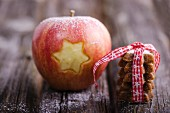A star carved into an apple and a stack of cinnamon stars