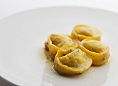 Tortellini with a butter sauce and herbs