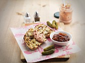 Pate on toasted bread, gherkins and relish