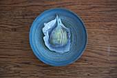 A fresh fig in a dish