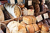 Various loaves of rustic bread on a market stall